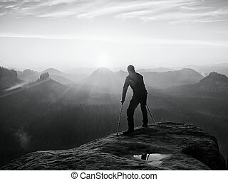 Bended man with broken leg and medicine crutch. Hiker with...