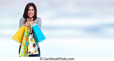 Happy customer. - Beautiful young woman with shopping bags....