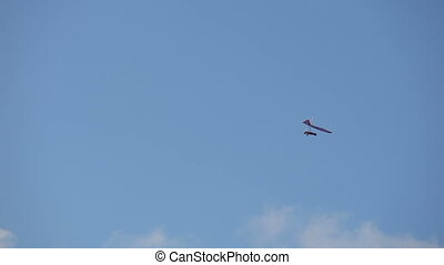 hang glider circling in the sky - hang glider circling fly...