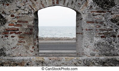 Hole in the Wall - View through a hole in the wall in...