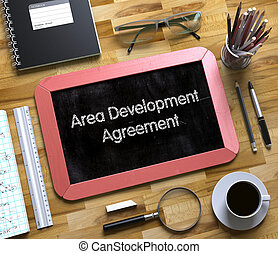 Area Development Agreement on Small Chalkboard. 3D. - Area...