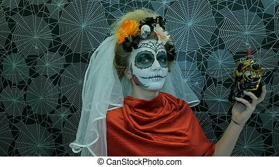 Portrait of a model wearing a mask for Halloween,...