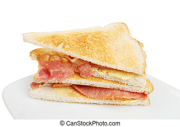 Toasted bacon sandwich on a plate against a white background