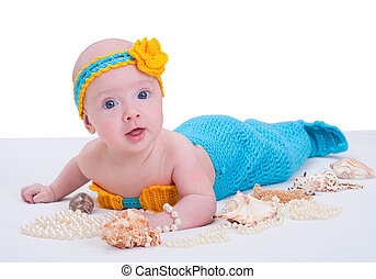 Baby girl dressed as a mermaid . Isolated on white...