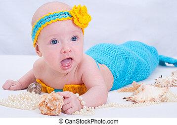 Baby girl dressed as a mermaid
