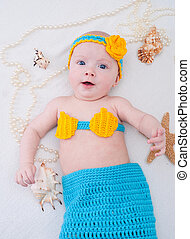 Baby girl dressed as a mermaid