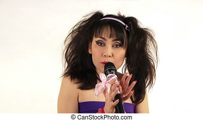 Singer sings on a white background