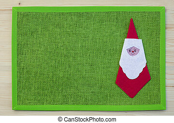 Santa claus serviette on place mat and wood, spruce, fir