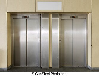 two elevators in the interior of a building
