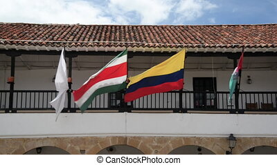 Flags in Villa de Leyva - Colombian and other flags blowing...