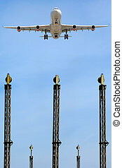 Plane over lights in airport - A plane is flying over the...