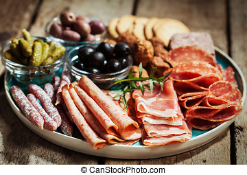 Cold cuts - Charcuterie assortment, olives and gherkins on...
