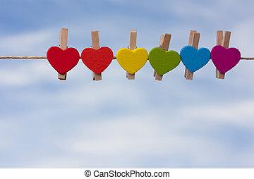 rainbow heart against the sky.