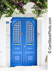 Blue gate of a house in Bodrum, Turkey - Blue gate of a...