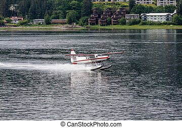 Brown and White Seaplane in Juneau - Seaplane in the harbor...