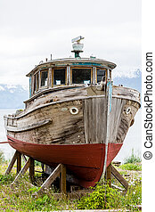 Red Keel on Dry Dock - Old Wooden Boat on Alaskan Dry Dock