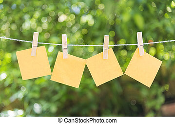 the four of sticky note hanging on the clothesline with the...