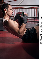 Man doing abdominal crunches with ball - Achieving results....