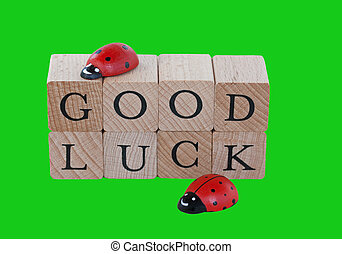 Good luck - The words good luck and ladybugs on wood,...