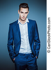 business clothing - Vogue shot of a handsome male model in...