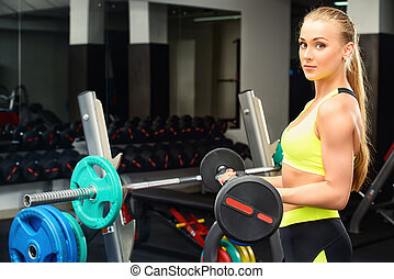 female bodybuilder - Slender young woman with beautiful...