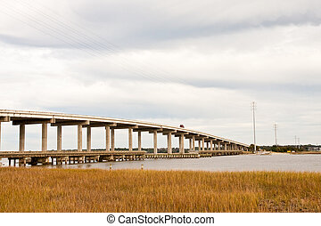 Concrete Bridge Over Expanse of Wetland Marsh - A concrete...