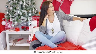 Cheerful woman in a festive Christmas home - Cheerful young...
