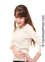 young woman suffers from lumbago - studio shot of young...