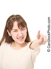 young woman scolding - portrait of young woman on white...