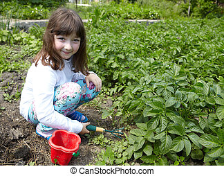 The little girl in the vegetable garden