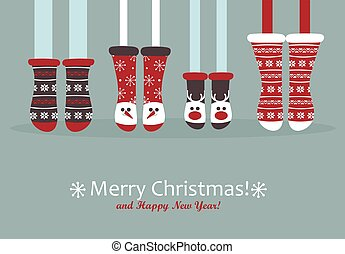 Family feet in Christmas socks. Winter holiday concept....