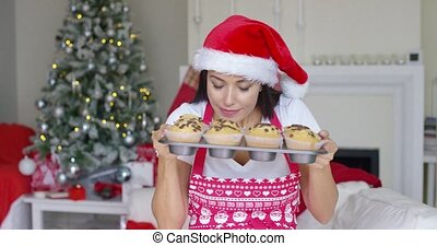 Charming young woman with fresh baked cookies - Charming...
