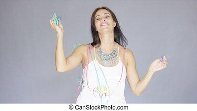Vivacious woman at a fun New Year party - Vivacious elegant...