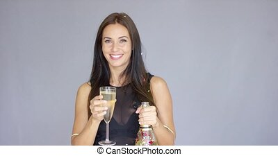 Charming woman welcoming in the New Year - Charming...