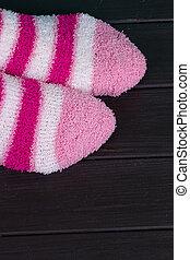 beautiful legs woman with socks standing on tiptoe on the...