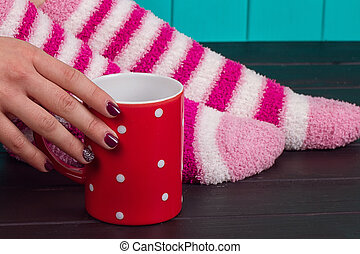 Close-up of female legs in bright colored warm socks