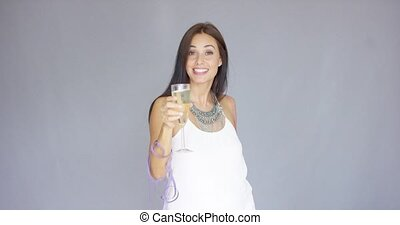 Beautiful chic young woman toasting the New Year - Beautiful...