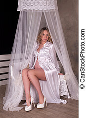 Pregnant woman in dressing- gown - Pretty pregnant woman in...
