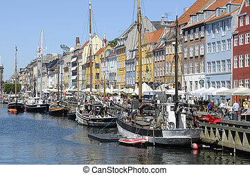 The shore in Copenhagen - The colorful city houses and boats...