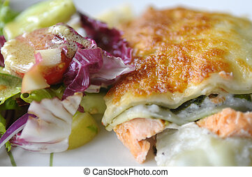 The lasagne with salmon - The detail of the lasagne with...