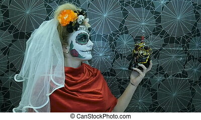 Portrait of a model wearing a mask for Halloween