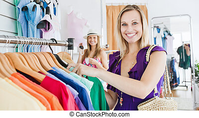 Two female friends doing shopping together