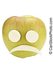 Apple smiley face with sad expression