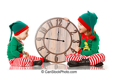 Christmas concept. Two little elf helper of Santa with clock...