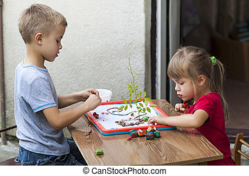 Children boy and girl playing together