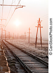 railroad in winter - snowy scene on a sunset with railroad