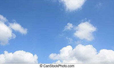 Time lapse stock footage of clouds passing over blue sky,...