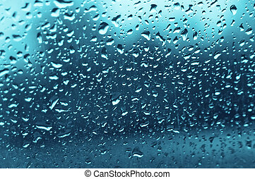 water drops on a glass in avto in rain
