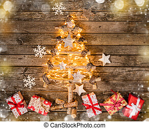 Christmas tree with gift boxes on wood - Christmas tree with...