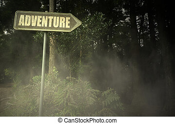 old signboard with text adventure near the sinister forest -...
